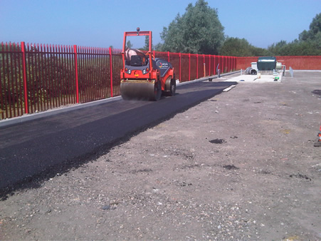 New car park resurface work begins as fresh tarmac is being put down